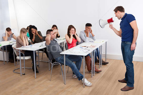 Stock photo: Teacher Shouting Through Megaphone On University Students