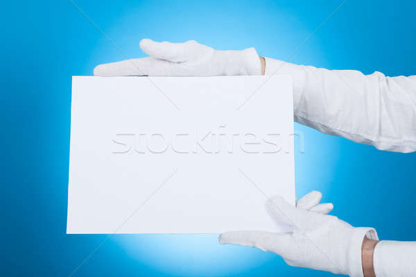 Butler Holding Blank Placard Stock photo © AndreyPopov