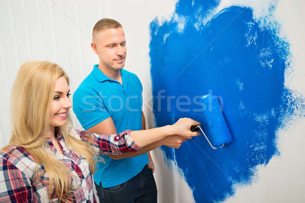 Young Couple Painting Wall Stock photo © AndreyPopov