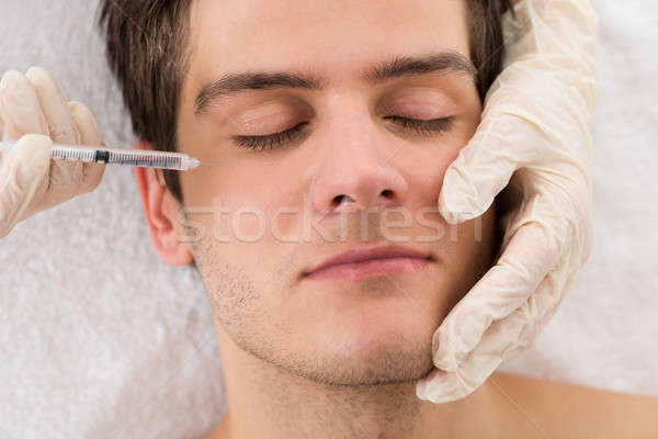 Homme traitement visage beauté Photo stock © AndreyPopov