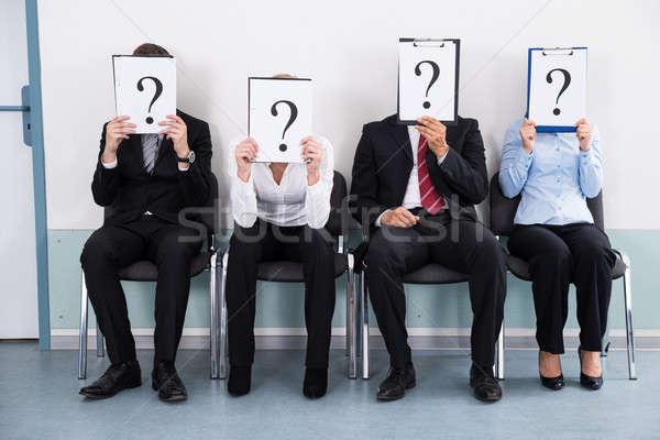üzletemberek rejtőzködik mögött kérdőjel felirat ül Stock fotó © AndreyPopov