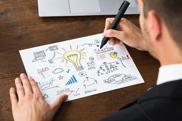Close-up Of Businessperson Making Start-up Plan Stock photo © AndreyPopov