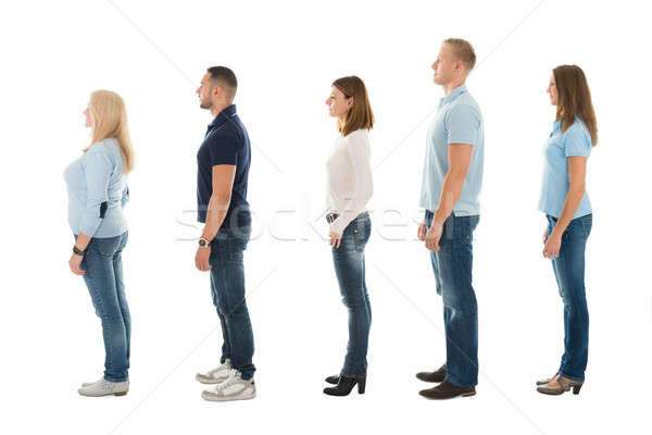 Side View Of People Standing In Queue Stock photo © AndreyPopov