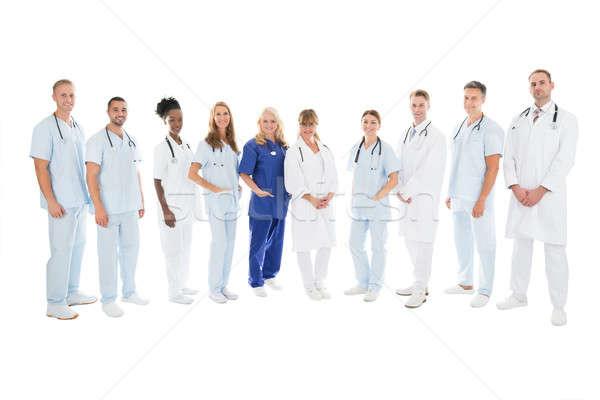 Confident Multiethnic Medical Team Standing In Row Stock photo © AndreyPopov