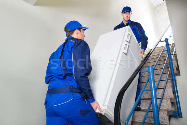 Movers Carrying Refrigerator On Steps At Home Stock photo © AndreyPopov