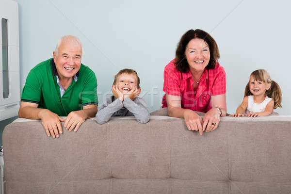 Portrait Of Multi Generation Family Leaning On Sofa Stock photo © AndreyPopov