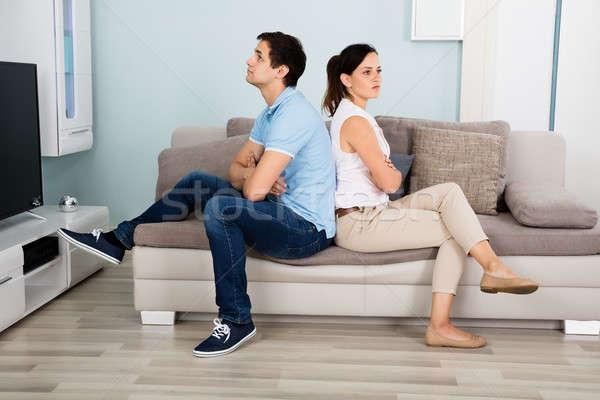 Casal sessão de volta sofá triste Foto stock © AndreyPopov