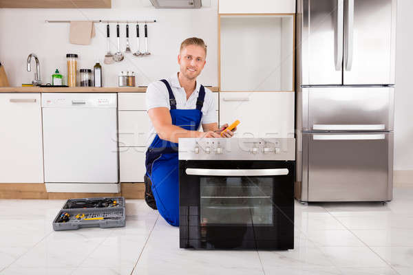 Technician Checking Oven With Digital Multimeter Stock photo © AndreyPopov