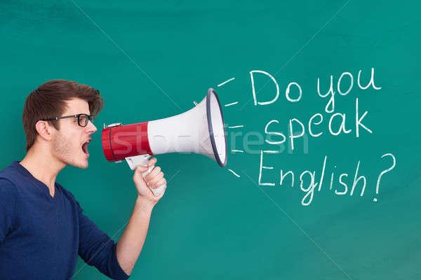 человека объявление английский мегафон молодым человеком Сток-фото © AndreyPopov
