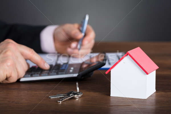 üzletember ház számológép modell kulcs fából készült Stock fotó © AndreyPopov