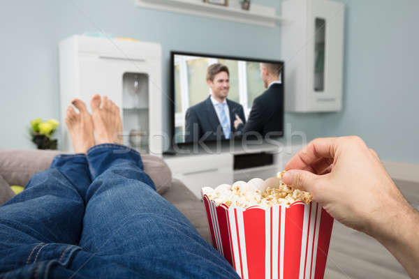 Person Watching Movie While Eating Popcorn Stock photo © AndreyPopov