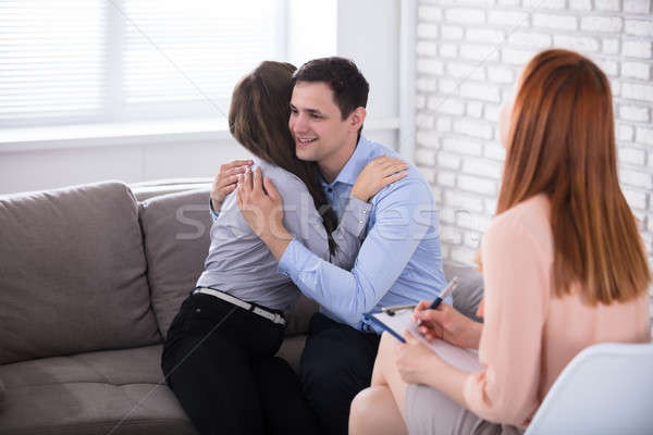Psychologist Looking At Couple Embracing Stock photo © AndreyPopov