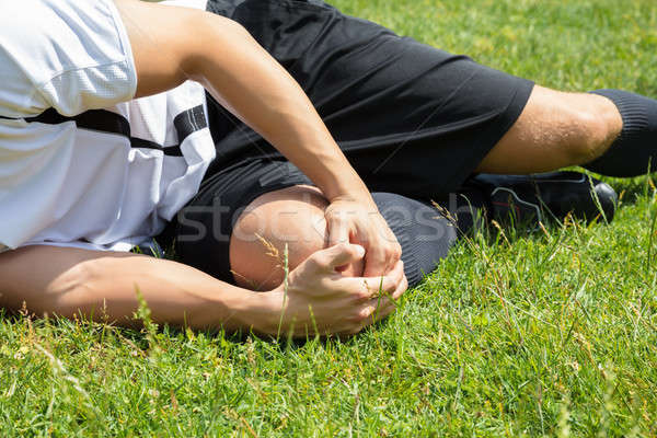 Male Player Suffering From Knee Injury Stock photo © AndreyPopov