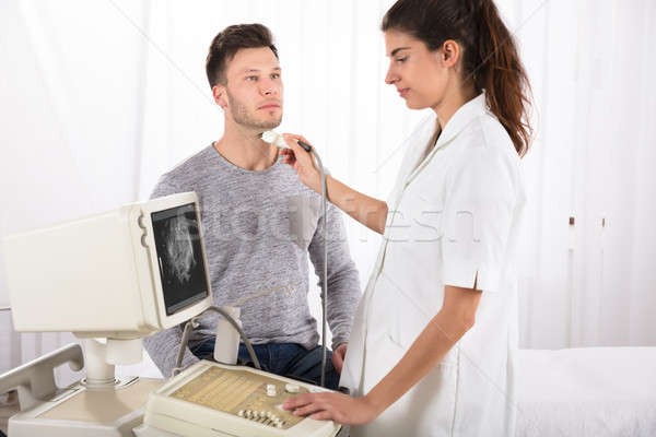 Male Patient Undergoing Ultrasound Of Thyroid Gland Stock photo © AndreyPopov