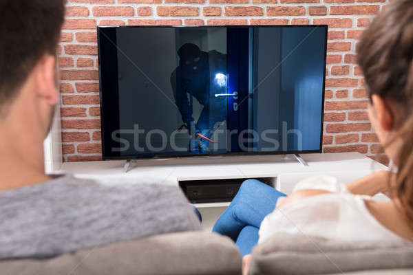 Couple Watching Film At Home Stock photo © AndreyPopov