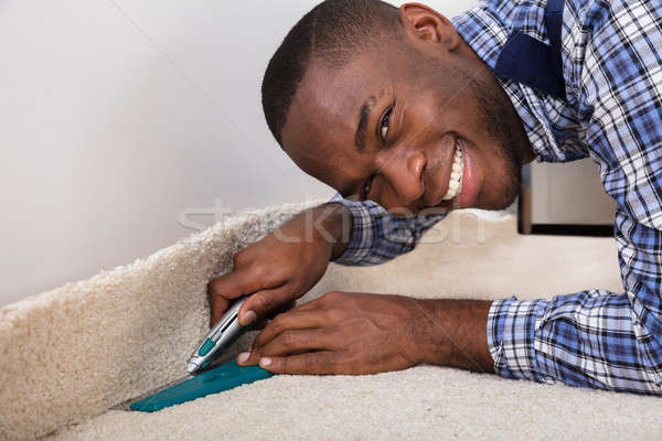 Craftsman Fitting Carpet Stock photo © AndreyPopov