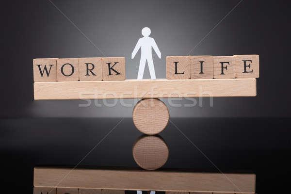 Human Figure Balancing Between Work And Life On Seesaw Stock photo © AndreyPopov
