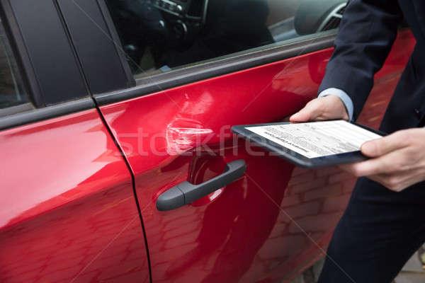 Human Hand Holding Digital Tablet Near Car Stock photo © AndreyPopov
