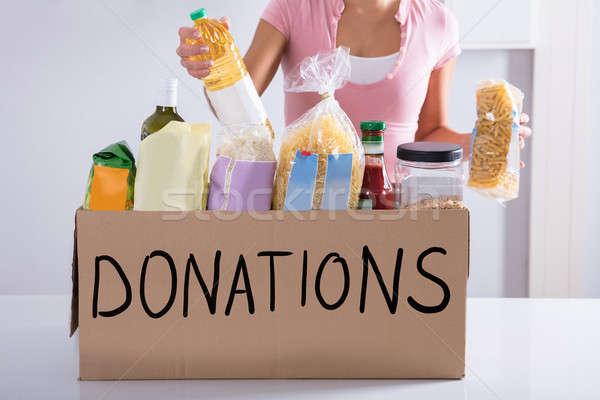Mujer donación cuadro mesa alimentos Foto stock © AndreyPopov