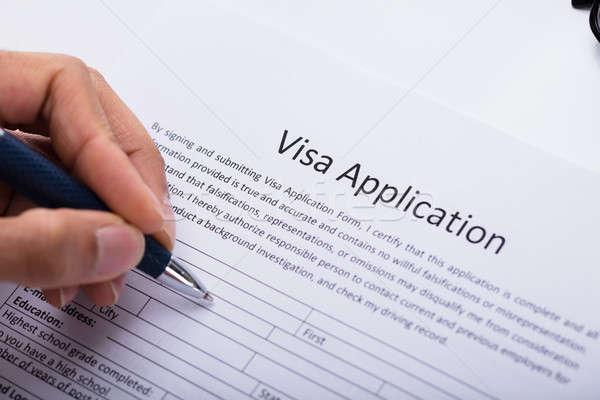 Persoon vulling visum toepassing vorm Stockfoto © AndreyPopov