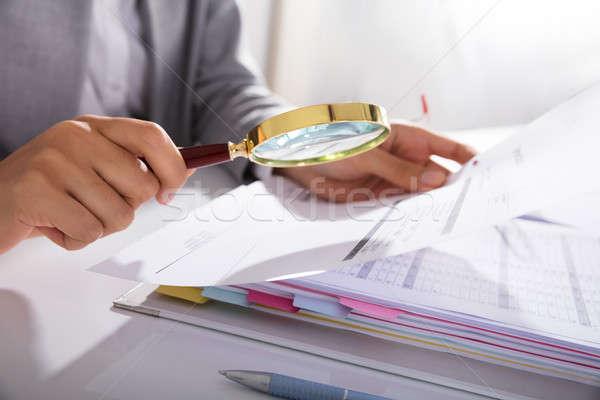 Businesswoman Analyzing Invoice Stock photo © AndreyPopov