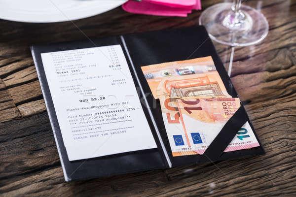 Kilátás számla bankjegy fából készült asztal papír Stock fotó © AndreyPopov