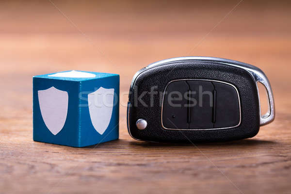 Shield Shape On Block With Car Key Stock photo © AndreyPopov