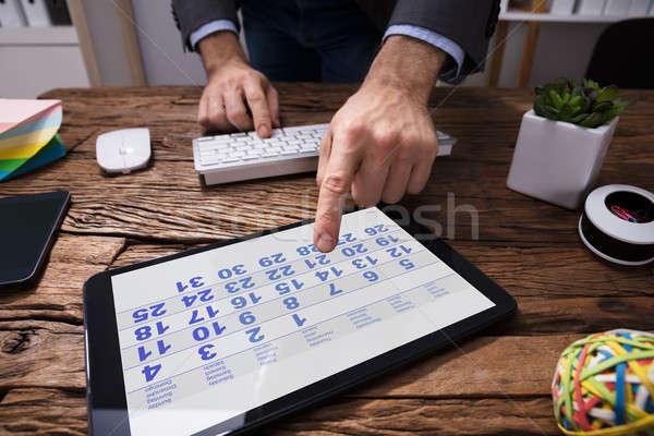 Businessperson Using Calendar In Digital Tablet Stock photo © AndreyPopov