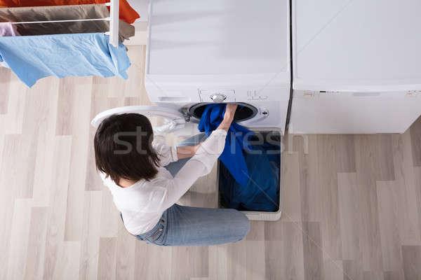 Woman Putting Dirty Cloth Into Washing Machine Stock photo © AndreyPopov