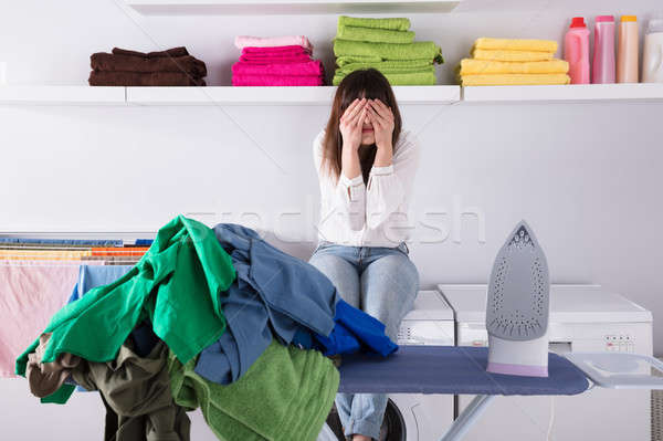 Pile Of Clothes And Iron On Ironing Board Stock photo © AndreyPopov