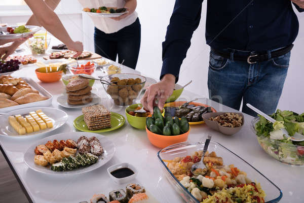 People Picking Food At Party Stock photo © AndreyPopov