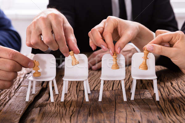Mãos xadrez cadeiras negócio verde Foto stock © AndreyPopov