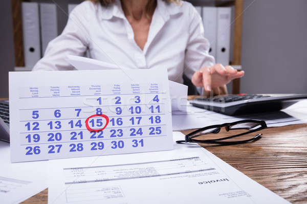 Close-up Of Calendar And Invoice On Wooden Desk Stock photo © AndreyPopov