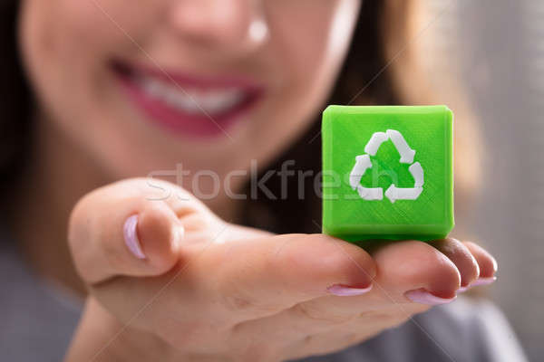 Woman Holding Cubic Block With Recycle Symbol Stock photo © AndreyPopov