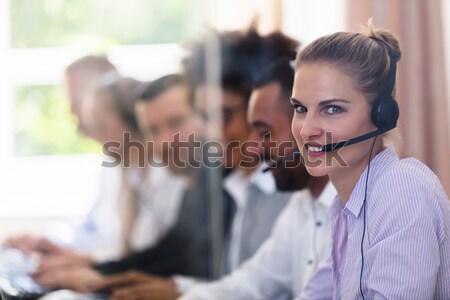 Happy Female Customer Service Executive Stock photo © AndreyPopov