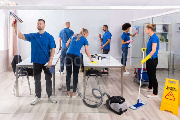Group Of Skilled Janitors Cleaning Office Stock photo © AndreyPopov