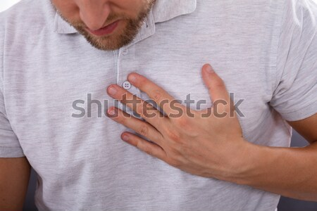 Man Having Acid Reflux Stock photo © AndreyPopov