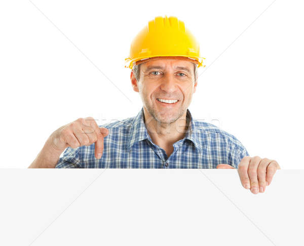Confident worker presenting empty board Stock photo © AndreyPopov