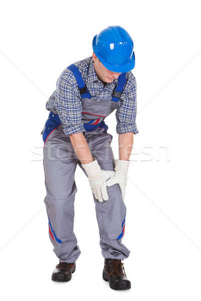Male worker suffering from knee pain Stock photo © AndreyPopov