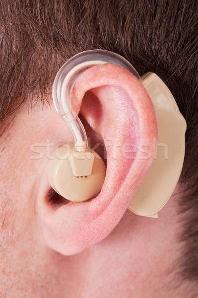 Aparat słuchowy ucha medycznych technologii komunikacji Zdjęcia stock © AndreyPopov