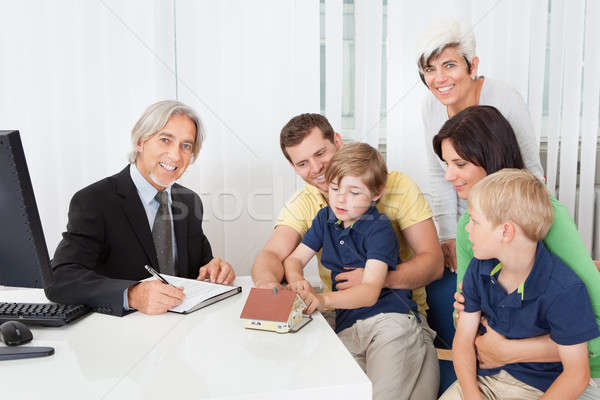 Family in real-estate agency Stock photo © AndreyPopov