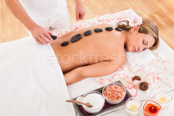 Hot stones lined on her back Stock photo © AndreyPopov