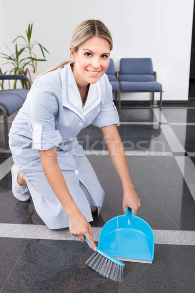 Young Maid Sweeping The Floor Stock photo © AndreyPopov