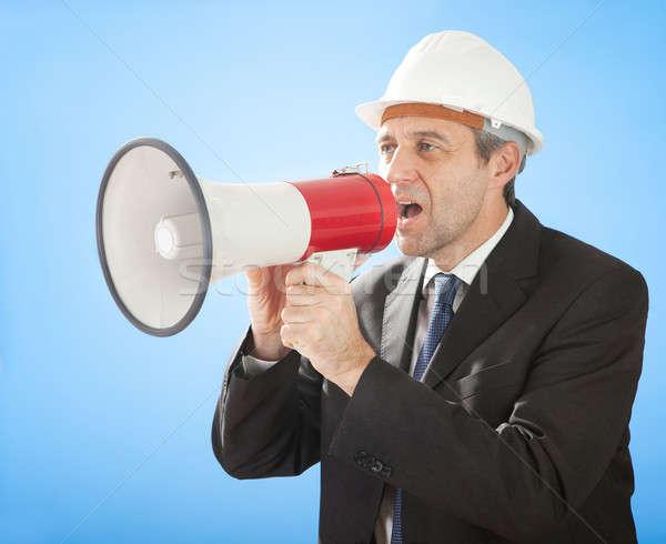 Senior architect shouting into megaphone Stock photo © AndreyPopov