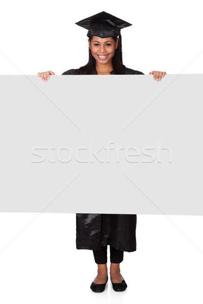 Graduate Woman Holding Placard Stock photo © AndreyPopov