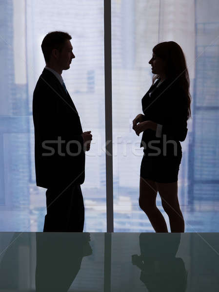 Business People Discussing By Office Window Stock photo © AndreyPopov