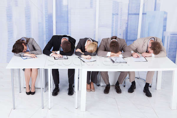 Tired Corporate Personnel Officers At Table Stock photo © AndreyPopov