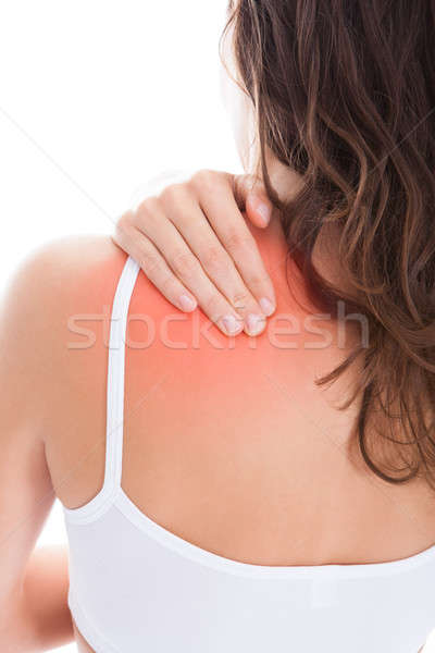 Frau Leiden Schulterschmerzen Schmerzen Schulter Stock foto © AndreyPopov
