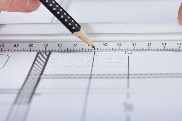 Architect Drawing On Blueprint Stock photo © AndreyPopov
