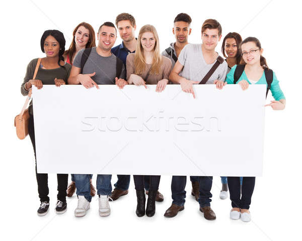 Stock photo: College Students Displaying Blank Billboard